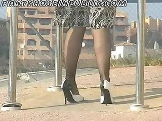 bitch wife in stockings flashes on street