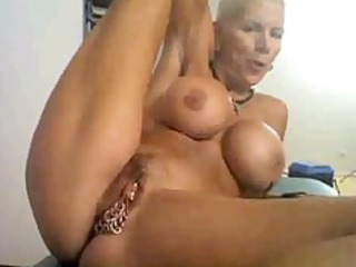 excited granny on cam, with many rings on her
