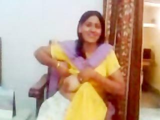 indian aunty showing her milk sacks