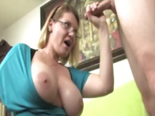 breasty older with glasses milking a lizard on