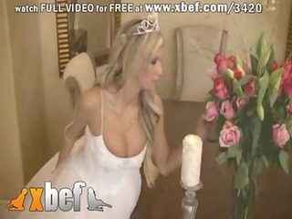 bride in glamorous wedding costume widening legs