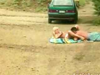 blond babe rides on pounder in park