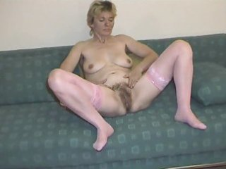 hairy aged in pink nylons disrobes