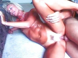 hot blond granny toys her cookie in advance of