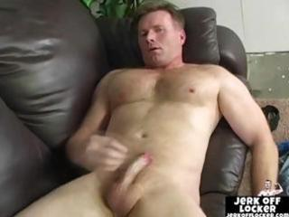 mature guy plays with his pipe