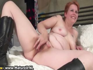 aged mom laying on the bed and rubbing part1