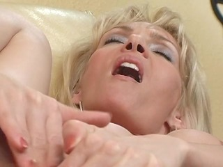 older blonde plays with herself