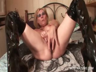 aged in latex boots masturbating twat with fingers