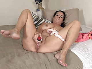 old mama masturbates, using her pants