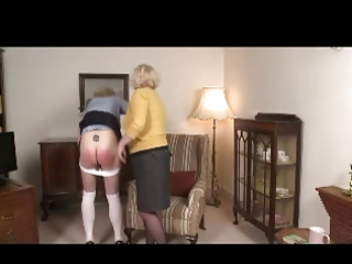 female-dominator granny spanks angel over her knee