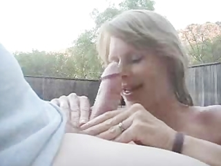 blond wife engulf hubby`s dick on the pool