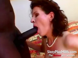 older housewife doing large darksome boy