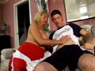 mature fat blond nibbles on his youthful boner