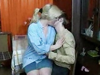 russian mama and lad having a swallow