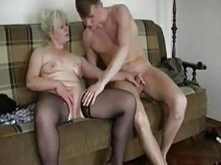 plump blond granny seduces a y...